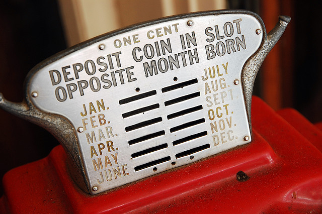 Deposit Coin In Slot Opposite Month Born by Steve Snodgrass