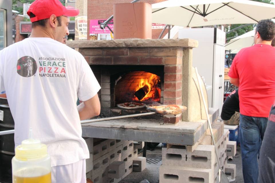 Baking Queen Margherita Pizza in a Wood Fire Oven by Rene S