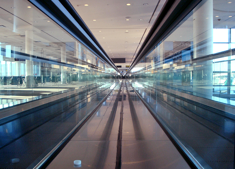 Airport Moving Walkway by Dean Jarvey