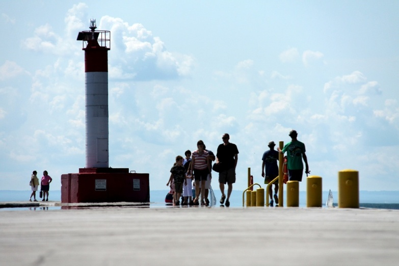 Afternoon walk on pier by lighthouse