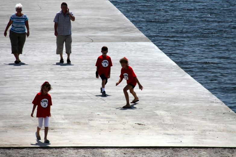 Kids playing on the pier