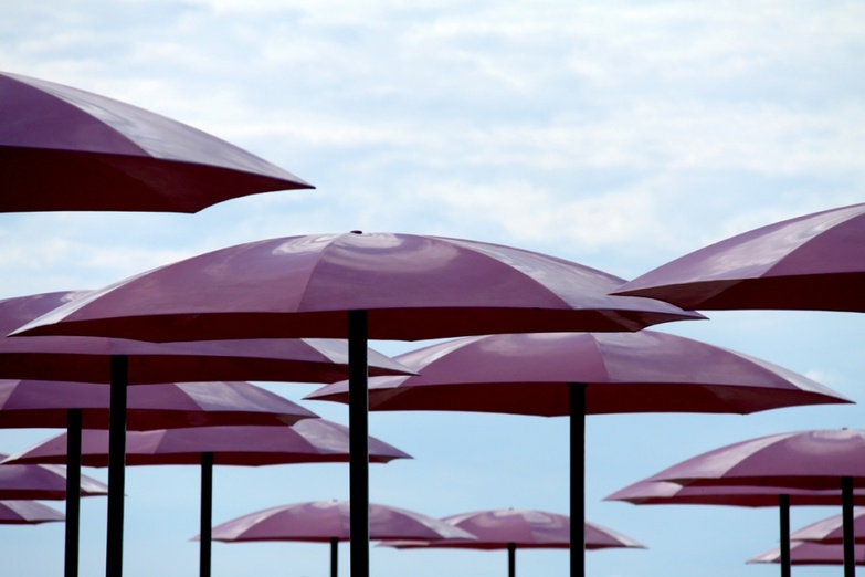 Sugar beach pink umbrellas against the sky