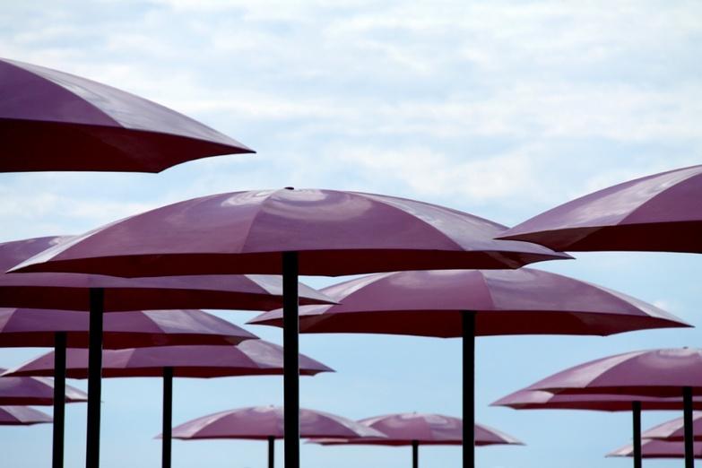 Sugar beach pink umbrellas against the sky