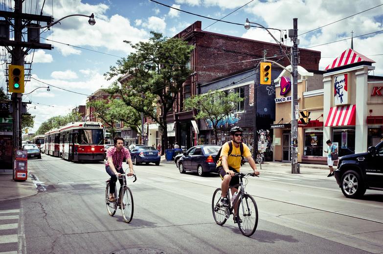 Bikers somewhere along Queen Street West By Benson Kua